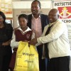 Mabe hands out school uniforms to learners